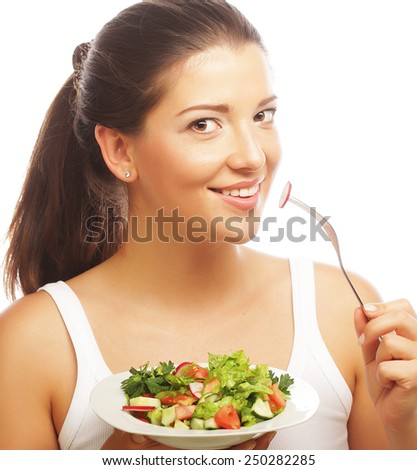 healthy lovely woman with salad on white background - stock photo