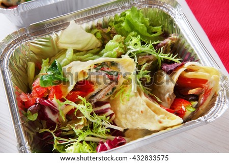 Healthy lunch. Fitness food. Weight loss nutrition diet, low carb food take away in aluminium container. Healthy food background. Vegetable salad with crepe closeup at white wooden table - stock photo