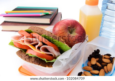 Healthy lunchbox with books and color pencils - stock photo