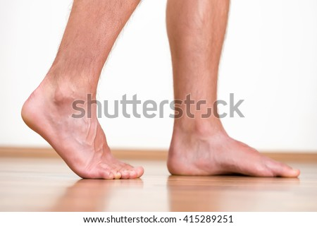 Healthy male feet feeling comfortable at home.