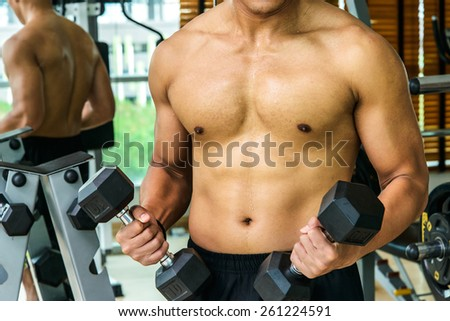 Healthy man doing Hammer Curl - stock photo