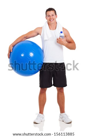 healthy man holding a gym ball isolated on white - stock photo