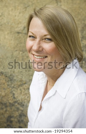 Healthy mature woman in an outdoor setting. Golden tones.