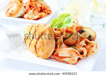 healthy meal, delicious chicken breast with pasta and glass of water