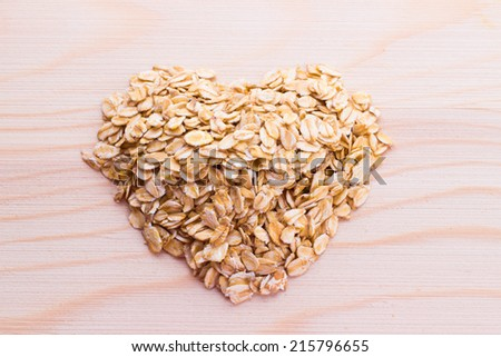 Healthy meal for heart: white oats lower blood cholesterol - stock photo
