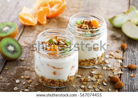 Healthy meal made of granola, yogurt and fruits. Delicious food for breakfast. Traditional American snack.