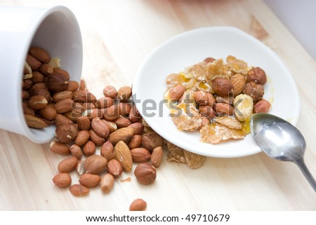 Healthy meal.Mix of nuts with honey - stock photo
