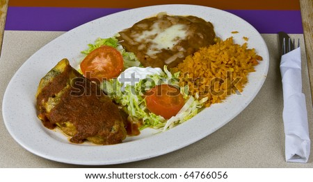 Healthy mexican meal, grilled beef and vegetables on plate - stock photo