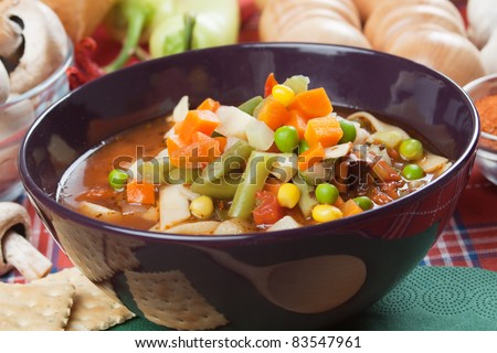 Healthy minestrone soup with carrot, peas, corn and other vegetables