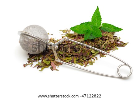 healthy mint tea and infuser - stock photo