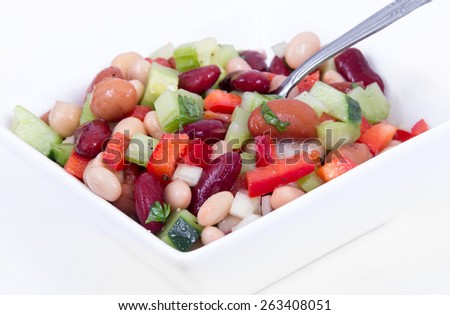 Healthy mixed bean salad bowl over white background - stock photo