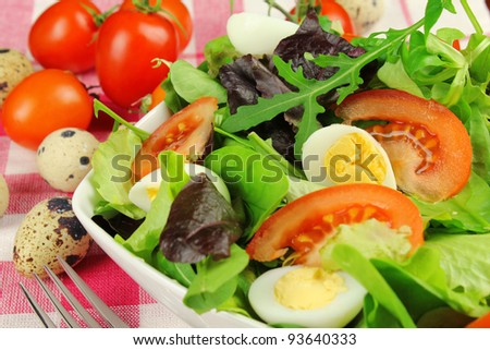 Healthy mixed salad with tomatoes and quail eggs