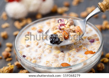 Healthy muesli breakfast with nuts and raisin - stock photo