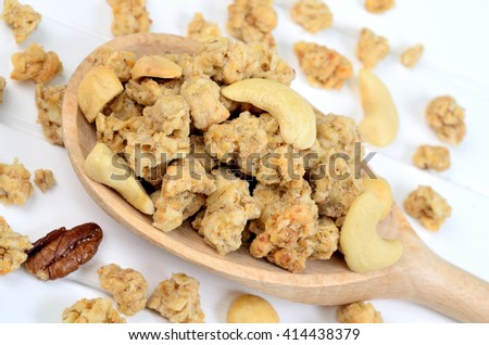 Healthy muesli in a wooden spoon
