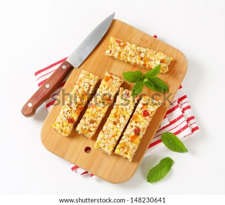 Healthy munchies on a cutting board - stock photo