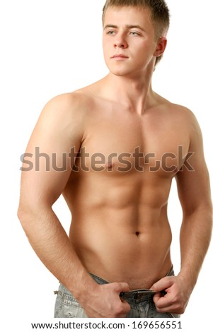 Healthy muscular man posing over white background - stock photo