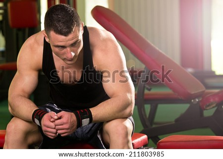Healthy muscular young man after a workout - stock photo