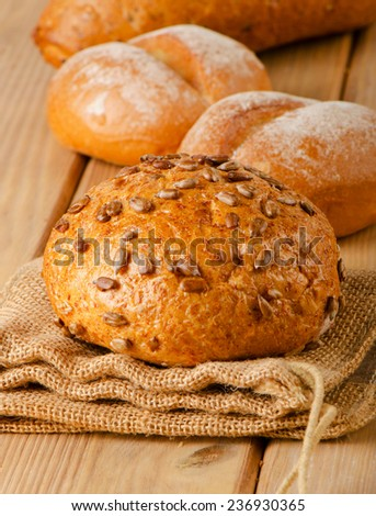 Healthy natural bread on a  wooden board . Selective focus - stock photo