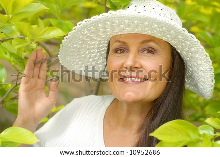Healthy older woman outside on a bright day - stock photo