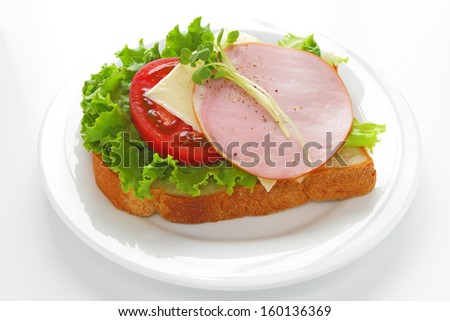 Healthy open sandwich with lettuce, tomato, ham and cheese isolated on white  - stock photo