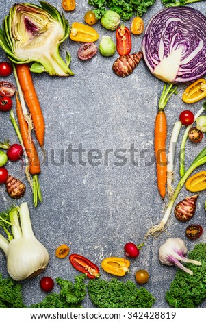 Healthy or vegetarian food background with assortment of fresh farm vegetables on gray rustic background, top view,frame. - stock photo
