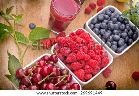 Healthy organic berry fruits and raspberry juice - stock photo