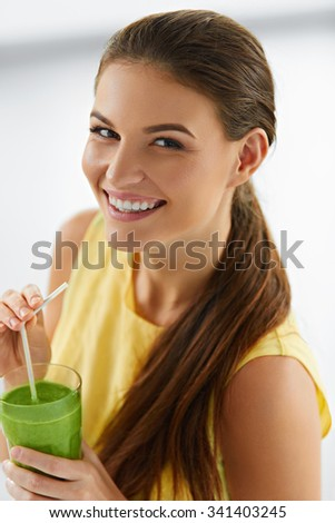 Healthy Organic Food. Happy Beautiful Smiling Woman Drinking Green Detox Vegetable Smoothie. Healthy Lifestyle, Meal And Eating. Drink Juice. Diet, Health And Beauty Concept. Nutrition - stock photo