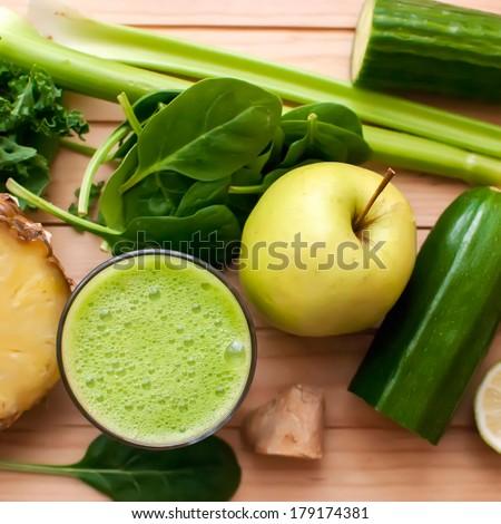 healthy organic green detox juice on wood - stock photo
