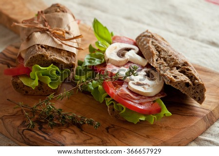 Healthy organic sandwiches with salad and tomatoes