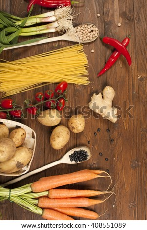 Healthy Organic Vegetables on a Wooden Background - stock photo