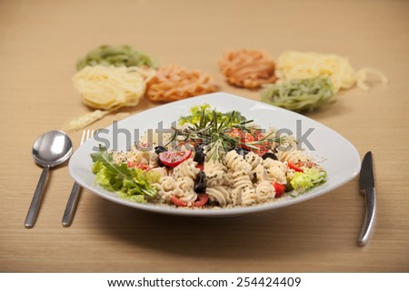 Healthy organic vegetarian salad served in the white tray, with wooden textured background  - stock photo