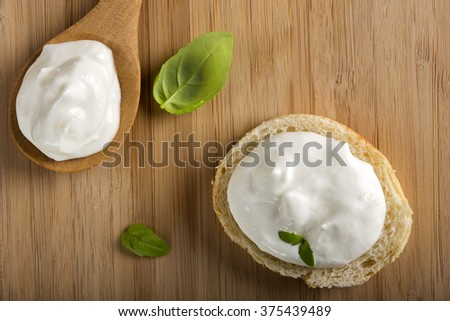 Healthy Organic Whole Grain bread and one spoon with Cream Cheese - stock photo