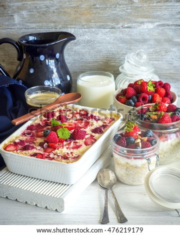 Healthy paleo oatmeal porridge baked with berries and overnight oats (Bircher muesli) for breakfast