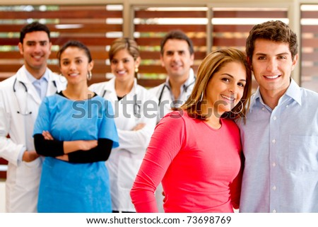 Healthy patients at the hospital with doctors on the background - stock photo