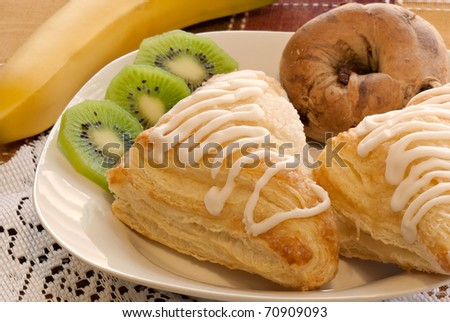 Healthy plate with pastries, banana, and kiwi - stock photo