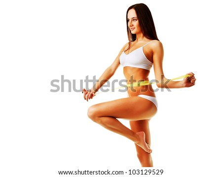Healthy pretty woman with yellow measure on white background - stock photo