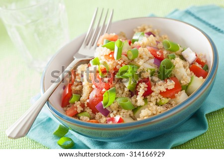 healthy quinoa salad with tomato cucumber onion chives - stock photo