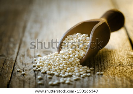Healthy quinoa seeds, a high protein vegetable from South America which forms an important part of the diet and is considered a staple, also sort after because it is gluten-free - stock photo