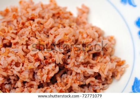 Healthy red unpolished rice commonly found in an Asian diet. Unpolished rice is known for its abundant minerals, vitamins, and soluble fiber.