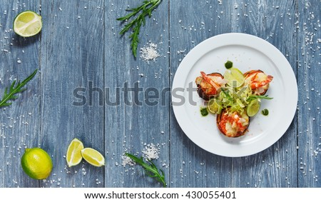 Healthy restaurant food. Ratatoille with cheese and shrimp top view, flat lay with copyspace at blue rustic wood background. Seafood vegetarian carpaccio. Healthy food, restaurant french cuisine. - stock photo