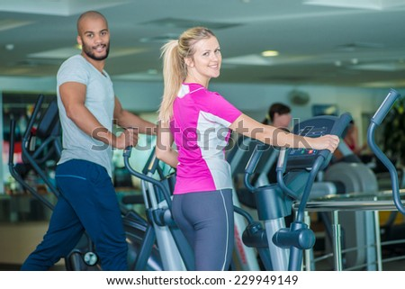 Healthy running. Athletes use the machine in the gym and look back - stock photo