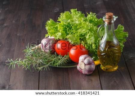Healthy salad ingredients on rustic wooden table - stock photo