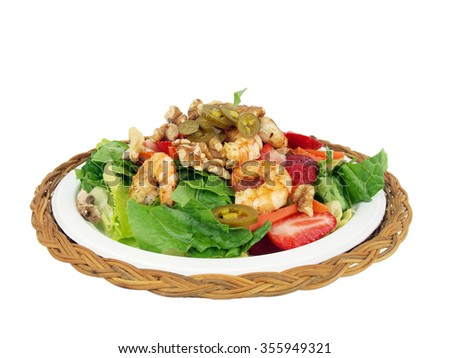 healthy salad of shrimp, lettuce, tomato. onion, pepper, walnuts and jalapeno on a white background