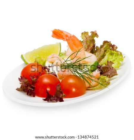 Healthy salad of shrimp, mixed greens and tomatoes - stock photo