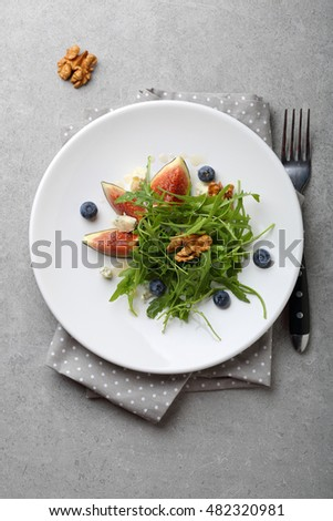 Healthy salad on white plate, food above