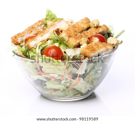 Healthy salad with chicken and vegetables in bowl - stock photo