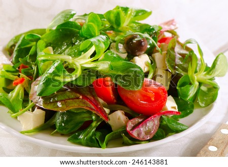 Healthy  Salad with feta cheese . Selective focus - stock photo