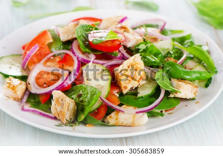 Healthy salad with grilled chicken breast. Selective focus - stock photo