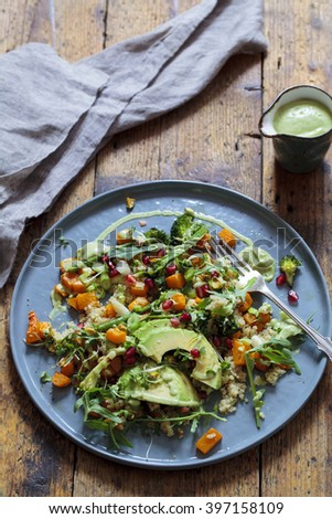 Healthy salad with quinoa, butternut squash, pomegranate and avocado