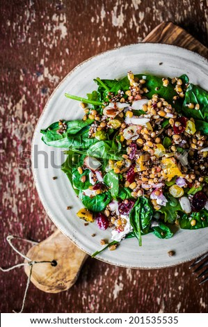 Healthy salad with spinach,quinoa and roasted vegetables - stock photo